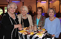 NWA Democrat-Gazette/CARIN SCHOPPMEYER Claudette Honeycutt (from left), Diane Breazeale, Elizabeth Weathers and Charlene Vinson gather at the Haute Trash Fashion Show.
