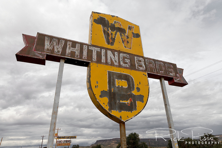 Weathered sign for the abandoned Whiting Bros gas station and motel still stands along Route 66 west of San Fidel, New Mexico