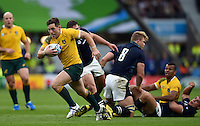 Bernard Foley of Australia goes on the attack. Rugby World Cup Quarter Final between Australia and Scotland on October 18, 2015 at Twickenham Stadium in London, England. Photo by: Patrick Khachfe / Onside Images