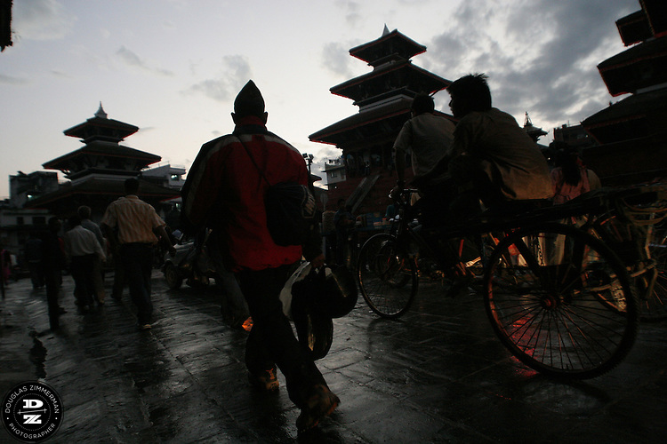 Pedestrians walk through Kathmandu's Durbar Square just after sunset.  Photograph by Douglas ZImmerman