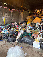 "Pictured: The pile of rubbish that had to be searched for the lost engagement ring.<br /> Re: A woman who accidentally threw away her engagement ring has thanked recycling centre staff for finding it among piles of rubbish in Monmouthshire, Wales, UK.<br /> Two workers at Five Lanes recycling centre in Caldicot, ""trawled through hundreds of bags"" to find it.<br /> Jo Carter realised on Saturday she had lost it and it had been taken to the tip along with 15 other black bags.<br /> Two Monmouthshire council workers spent four hours trying to find it.<br /> Mr and Mrs Carter got engaged 15 years ago, but she did not put on the £3000 ring very often."
