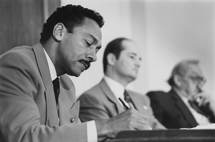 Rep. Mel Watt, D-N.C., attends Judiciary Subcommittee on civil rights and Constitution in Rayburn House Office Building. Rep. Charles T. Canady, R-Fla., and Rep. Howard Coble, R-N.C., who are on the committee are seen on the right on Oct. 18, 1993. (Photo by Laura Patterson/CQ Roll Call)