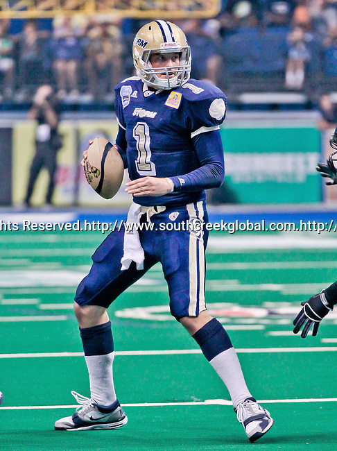 Aug 14, 2010: Tampa Bay Storm quarterback Brett Dietz (#1) leads the Storm to victory over the Orlando Predators. The Storm defeated the Predators 63-62 to win the division title at the St. Petersburg Times Forum in Tampa, Florida. (Mandatory Credit:  Margaret Bowles)