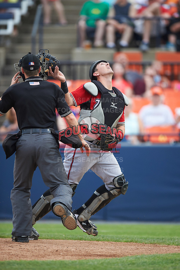 Carolina Mudcats catcher Joseph Odom (6) looks for a popup foul ball in front of umpire Chris Marco during a game against the Frederick Keys on June 4, 2016 at Nymeo Field at Harry Grove Stadium in Frederick, Maryland.  Frederick defeated Carolina 5-4 in eleven innings.  (Mike Janes/Four Seam Images)