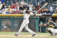 Juan Ciriaco (13) of the Fresno Grizzlies at bat against the Salt Lake Bees at Smith's Ballpark on May 25, 2014 in Salt Lake City, Utah.  (Stephen Smith/Four Seam Images)