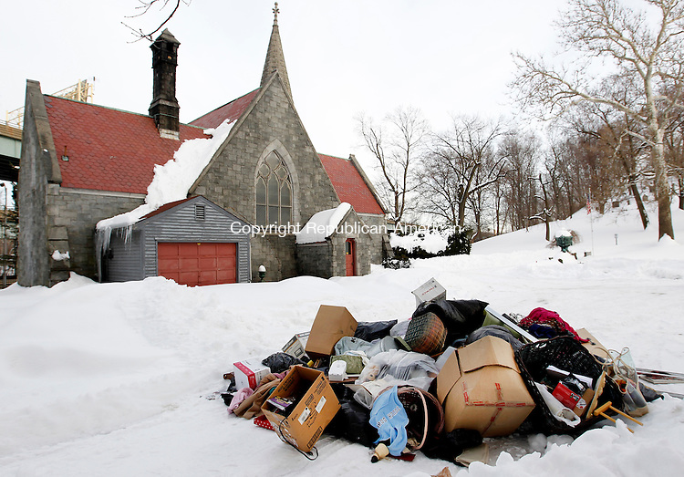 Waterbury, CT- 31, January 2010-013111CM03 An unknown person or persons, dropped off a large pile of trash behind the Chapel at the Riverside Cemetery in Waterbury over the weekend.  Some of the items included clothes, a bed frame and other home furnishings. The Board of Trustees of the Riverside Cemetery Association said they are extremely upset that people would do something like this in a cemetery.  Christopher Massa Republican-American