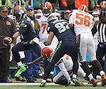 Seattle Seahawks quarterback Russell Wilson stretches for a first down against the  Cleveland Browns at CenturyLink Field in Seattle, Washington on December 20, 2015. The Seahawks clinched their fourth straight playoff berth in four seasons by beating the Browns 30-13.  ©2015. Jim Bryant Photo. All Rights Reserved.