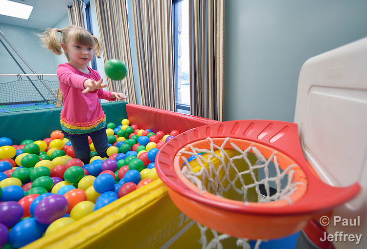 Four-year old Karis Andrews enjoys playing in the sensory-motor playroom at University United Methodist Church in San Antonio, Texas. The room is part of the congregation's special needs ministries, and is open to the community, providing access to therapeutic toys and equipment at no cost to children with developmental delays.