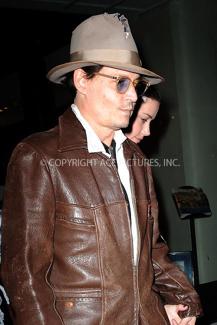 WWW.ACEPIXS.COM<br /> April 22, 2014 New York City<br /> <br /> Johnny Depp and Amber Heard visit Bauman Rare Books in New York City on April 22, 2014.<br /> <br /> By Line: Kristin Callahan/ACE Pictures<br /> ACE Pictures, Inc.<br /> tel: 646 769 0430<br /> Email: info@acepixs.com<br /> www.acepixs.com
