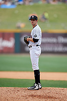 Birmingham Barons relief pitcher Connor Walsh (9) gets ready to deliver a pitch during a game against the Pensacola Blue Wahoos on May 9, 2018 at Regions FIeld in Birmingham, Alabama.  Birmingham defeated Pensacola 16-3.  (Mike Janes/Four Seam Images)