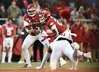 NWA Democrat-Gazette/CHARLIE KAIJO Arkansas quarterback K.J. Jefferson (13) hands the ball off to running back A'Montae Spivey (24), Saturday, November 2, 2019 during the fourth quarter of a football game at Donald W. Reynolds Razorback Stadium in Fayetteville. Visit nwadg.com/photos to see more photographs from the game.
