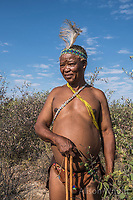 Africa, Botswana, Khwai, The Lodge, Feline Fields, edge of the Kalahari desert. Kalahari bush people, Ju'hoansi tribe. Hunter-gatherer !Kung people, part of San tribe. Although they are no longer legally allowed to hunt, the tribe shows how they use their bow and arrow and make guineau fowl traps. The also show how they gather different berries and herbs for eating and using as insect repellent. The elder tribesman still know how to find the large tubers (Qhgwaa) that they dig up to drink from for hydration. In the rainy season they use ostrich shells to store water. They also can still make fire by rubbing sticks together.