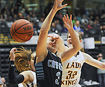 Chugiak's Nicole Pinckney is fouled on her way to the hoop by Ketchikan's Eliah Anderson in the state basketball tournament.   Photo for the Star by  Michael Dinneen