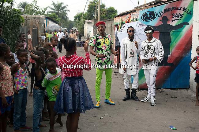 "KINSHASA, DEMOCRATIC REPUBLIC OF CONGO - FEBRUARY 12: A Sapeur group in the streets, on February 12, 2017 in Kinshasa, DRC. The word Sapeur comes from SAPE, a French acronym for Sociéé des Ambianceurs et Persons Élégants. or Society of Revellers and Elegant People. It also means to dress with ""elegance and style"". Most of the young Sapeurs are unemployed, poor and live in harsh conditions in Kinshasa, a city of about 10 million people. For many of them being a Sapeur means they can escape their daily struggles and dress like fashionable Europeans. Many hustle to build up their expensive collections. Most Sapeurs could never afford to visit Paris, and usually relatives send or bring clothes back to Kinshasa.  (Photo by Per-Anders Pettersson)"