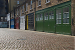 Cobbled Mews street. Traditional mews housing London. Cromwell Mews London SW7 UK.