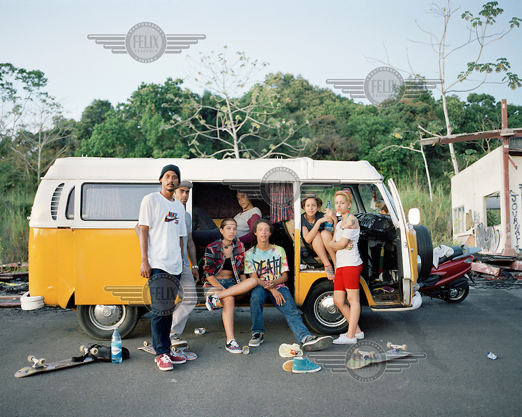 A group of skateboarders in their VW Camper Van at the former US Army base at Fort Clayton. Until it closed in 1999, in accordance with the Torrijos-Carter Treaties, both the Southern Command Network and 193rd Infantry Brigade were headquartered there.  <br /> <br /> The Panama Canal Zone is an area extending 8kms out, in each direction, from the waterway's central line, was a territory controlled by the United States between 1903 and 1979. After a 20 year period of joint administration, the Canal came under the full control of Panama in 1999. The Canal opened to shipping in 1914 and during its tenure was of great strategic importance to the US, enabling it to rapidly move its naval fleet between the Atlantic and Pacific Oceans. However, its economic value came not directly from shipping fees but from the stimulus to trade that the waterway created. One hundred years after it opened in 2014 it is due to have its locks upgraded to cater for the super sized container ships of the 21st Century. <br />  <br /> During the era of American administration thousands of US citizens populated the Canal Zone, living and working under US law in towns built to American standards. Not all of these people returned north after the canal came under full Panamanian control many stayed on, their identities tied to the region.
