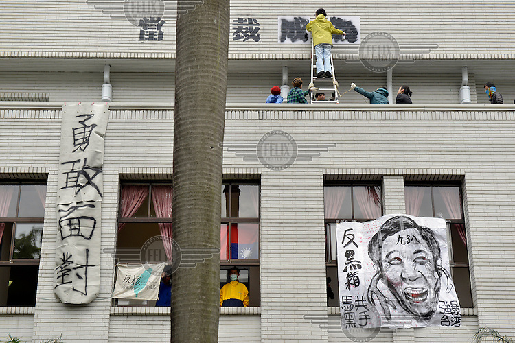 "Protestors stencil a sign onto the wall of Taiwan's Legislative Yuan (Parliament) building on the 4th day of its occupation by students opposed to the passing of the Cross-Straight Service and Trade Agreement between Taiwan China. The sign reads: 'When dictatorship becomes reality, revolution becomes our duty.' A caricature of Taiwan's President Ma ying-joeh hangs in the window.  The students, and many normal Taiwanese, fear the erosion of their hard-won democracy and, eventually, independence, making them, in the words of one student protestor 'no better off than Hong Kong'. Ma ying-jeoh bears the brunt of the protestors ire; known as ""Ma 9%"" after his latest approval rating, he is seen as kowtowing to the demands of China and selling out Taiwan."