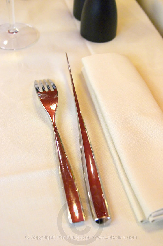 Silverware knife and fork on linen table cloth and napkin, the restaurant Blanc Le Bistrot in Toulon, very design art-deco Toulon Var Cote d'Azur France
