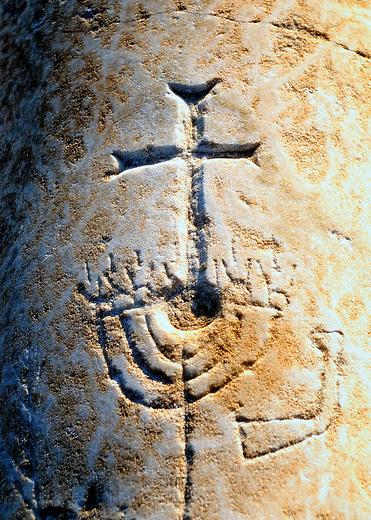 Christian cross and Jewish menorah on a marble pillar in Laodicea, Turkey