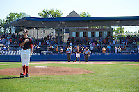 Batavia Muckdogs pitcher Dustin Beggs (47) stands for the national anthem before a game against the Auburn Doubledays on September 5, 2016 at Dwyer Stadium in Batavia, New York.  Umpires Emil Jimenez (left) and Robert Nunez (right) stand with catcher Alex Jones (55) at home plate.  Batavia defeated Auburn 4-3. (Mike Janes/Four Seam Images)