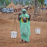Aisha Albaqir carries water in the Kaya Refugee Camp in Maban County, South Sudan. The camp shelters thousands of refugees from the Blue Nile region of Sudan, and Jesuit Refugee Service, with support from Misean Cara, provides educational and psycho-social services to both refugees and the host community.