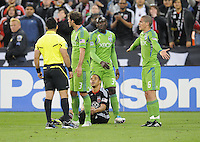 DC United forward Charlie Davies gets fouled by Seatle Sounder midfielder Osvaldo Alonso (6)  DC United defeated The Seattle Sounders 2-1, at RFK Stadium, Wednesday  May 4, 2011.