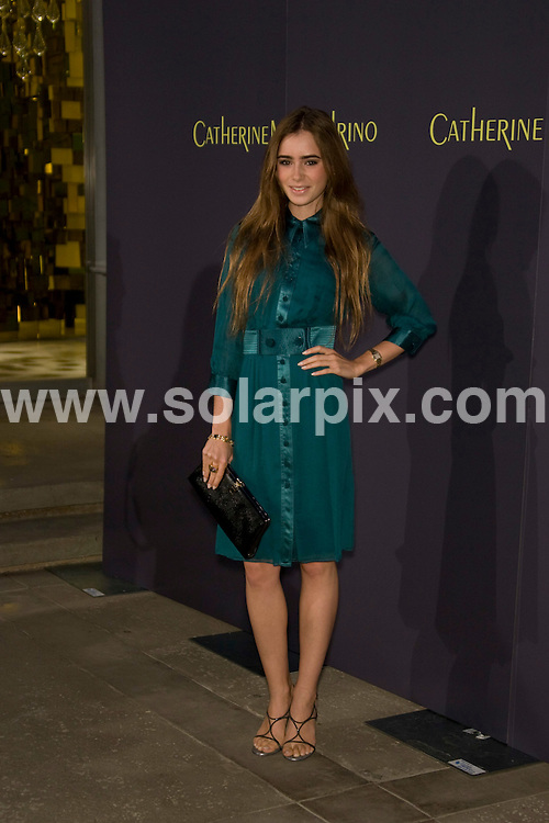 **ALL ROUND PICTURES FROM SOLARPIX.COM**.**SYNDICATION RIGHTS FOR UK, SPAIN, PORTUGAL, AUSTRALIA, S.AFRICA & DUBAI (U.A.E) ONLY**.the Grand Opening of Catherine Malandrino Maison in West Hollywood, California, USA. 20th October 2008..This pic: Lily Collins..JOB REF: 7646 PHZ (Hatcher)   DATE: 20_10_2008.**MUST CREDIT SOLARPIX.COM OR DOUBLE FEE WILL BE CHARGED* *UNDER NO CIRCUMSTANCES IS THIS IMAGE TO BE REPRODUCED FOR ANY ONLINE EDITION WITHOUT PRIOR PERMISSION*