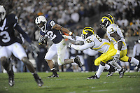 18 October 2008:  Penn State RB Evan Royster (22) runs away from Michigan DE Brandon Graham (55).  Royster ran for 176 yards and a TD.  The Penn State Nittany Lions defeated the Michigan Wolverines 46-17 October 18, 2008 at Beaver Stadium in State College, PA..