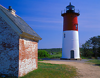 Cape Cod National Seashore, MA <br /> Nauset Lighthouse and weathered brick utility building in evening light, at Eastham, MA