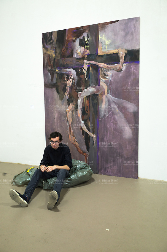 "Switzerland. Canton Ticino. Lugano. Opening of CSIA students' exhibition at the Ex Macello. The student Daniel Drabek sits on the ground on a plastic sheet near his painting, called ""Dipinto inrisolto"". Daniel Drabek is a student from the Maturità professionala (2016-2017) at Centro scolastico per le industrie artistiche (CSIA). 3.06.2017 © 2017 Didier Ruef"