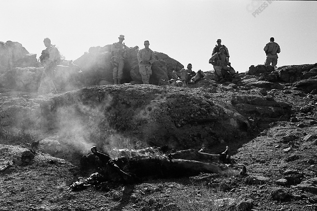 US forces of 1st Battalion, 508th Infantry Regiment of the 173rd Airborne Brigade burn the bodies of two Taliban dead during operations to find Taliban in Gonbaz village in Shawali-Kot in Kandahar Province, October 1st 2005.