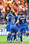 09 July 2006: Italy teammates swarm Marco Materazzi (ITA) (arms raised) following his 19th minute goal. Italy tied France 1-1 in overtime at the Olympiastadion in Berlin, Germany in match 64, the championship game, of the 2006 FIFA World Cup Finals. Italy won the World Cup by defeating France 5-3 on penalty kicks.