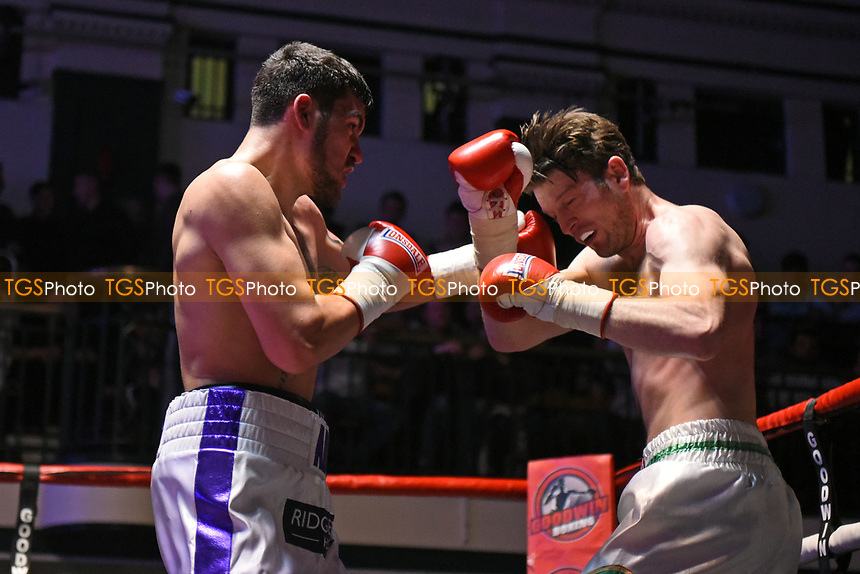 Adi Burden (white/blue shorts) defeats Andy Neylon during a Boxing Show at York Hall on 11th March 2017