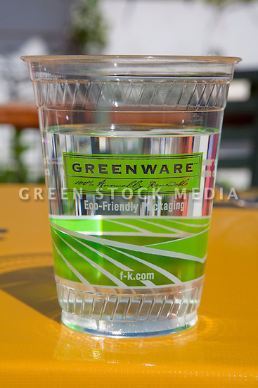 Close-up of one Fabri-Kal's Greenware cold drink cup full of water. Made in America from NatureWorks Ingeo biopolymer, a resin derived entirely from plants. The cups are used for drinking water for customers at the outside tables of the Coast Cafe in Bolinas, California. USA