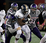SIOUX FALLS, SD - OCTOBER 4: Jermaine Clemon #3 from Concordia St. Paul is brought down by Broughan Jantz #47 from the University of Sioux Falls in the second half of their game Saturday evening at Bob Young Field.(Photo by Dave Eggen/Inertia)
