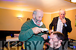 A PRACTICED SHEARER:  No stranger to shearing the animal kind, TD Danny Healy Rae cuts a path through the human kind as he takes a strip off the head of local lad Patie Looney while MC for the event Cllr Dan McCarthy looks on in astonishment.  The proceeds of the charity shave and wax night held in Healy Rae's Bar, Kilgarvan went to the Kerry/Cork Cancer Link Bus.