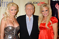 "27 September 2017 - Hugh Marston Hefner aka ""Hef"" was an American magazine publisher, editor, businessman, and international playboy best known as the editor-in-chief and publisher of Playboy magazine, which he founded in 1953. Hefner was the founder and chief creative officer of Playboy Enterprises, the publishing group that operates the magazine. Hefner was also a political activist and philanthropist. File Photo: 13 December 2007 - Hollywood, California - Holly Madison, Hugh Hefner and Bridget Marquardt. ""Remember To Give"" 2007 Holiday Party at Les Deux. Photo Credit: Byron Purvis/AdMedia (Newscom TagID: admphotos257323.jpg) [Photo via Newscom]"