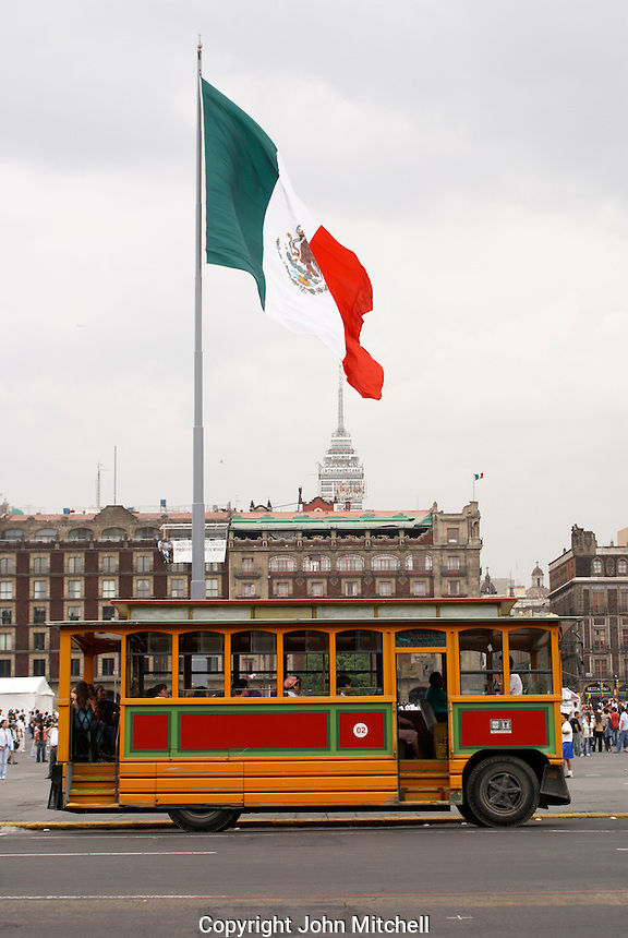 Tourist sightseeing trolley parked next to the Zocalo in Mexico City