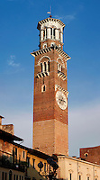 Low angle view of Torre dei Lamberti (Lamberti Tower), 12th century, Verona Italy. Construction of the 84 metre high brick, tuff brick and marble tower began in 1172. Lightening knocked off the top of the tower in 1403, and it was restored and raised from 1448 to 1463-64. The clock was added in 1779. Picture by Manuel Cohen.