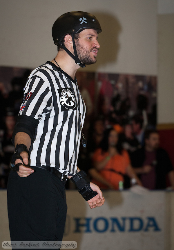 "Back Pack Referee Cameltron has a ""WTF?!?"" expression as he watches a group of skaters."