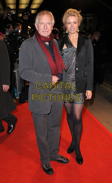 "PETER WEIR & GUEST .attending ""The Way Back"" UK film premiere, Curzon Mayfair cinema, London, England, UK,.8th December 2010 ..full length grey gray suit red scarf .CAP/BEL.©Tom Belcher/Capital Pictures."