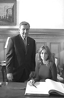French actress Emanuelle Beart(R)  who is the President of the 25th  World Film Festival's  Jury posewith Montreal Mayor; Pierre Bourque (L) after signing the golden book at Montreal,s City Hall<br /> August 29 th , 200l in Montreal, CANADA.<br /> <br /> Brought up on a farm in Provence because her father, French singer and poet Guy BÈart didn't want her to be affected by the glamour world of Paris showbusiness, Emmanuelle BÈart nevertheless got the acting urge in early adolescence. At age 15, after a couple of bit parts, she came to Montreal as an au pair to learn English. Back in France, after acting lessons and few small roles in television, she made her big-screen breakthrough in the title role of Claude Berri's Pagnol adaptation, MANON OF THE SPRING (1986). A year later she made her Hollywood debut in Tom McLoughlin's DATE WITH AN ANGEL. She has since played for some of the premier directors on both sides of the Atlantic: Rivette (LA BELLE NOISEUSE, 1991), Sautet (NELLY AND MR. ARNAUD (1995), Chabrol (L'ENFER,1994), De Palma (MISSION: IMPOSSIBLE, 1996) and Ruiz (TIME REGAINED, 1999). She stars in Catherine Corsini's REPLAY, showing at this year's Festival.<br /> <br /> <br /> <br /> <br /> Photo by Pierre Roussel / Getty Images (ON SPEC)<br /> <br /> NOTE : Nikon D-1 JPEG opened with QUIMAGE ICC profile , saved as Adobe RG 1998 color space.