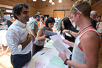 Occidental College faculty meet with students and parents during the Academic Department Fair in the Tiger Cooler, Orientation, Aug. 22, 2014. (Photo by Marc Campos, Occidental College Photographer)