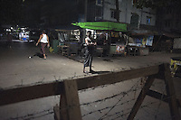 Muslims in Yangon set up barricades and night watches to protect their neighborhood from possible attacks.
