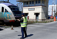 Pictured: A security man at the entrance to the OSE freight depot in Thessaloniki, Greece. Wednesday 05 April 2017<br /> Re: A year after an agreement was signed between Greece and Turkey for the management of refugees. Migrants, mostly from Morocco, Algeria and Tunisia, have been living in disused train carriages at the Thessaloniki freight depot of OSE in northern Greece, the company managing the railways in the country. Some of the migrants climb onto moving trains, or even hide themselves in storage areas, hoping that they will cross the border.