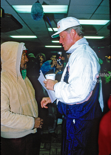 United States President-elect Bill Clinton speaks with Lucas Lansing, a homeless man, at a McDonald's near the White House during his visit to Washington, D.C. on November 19, 1992.  The President-elect stopped while taking a morning jog to chat with customers..Credit: Jeff Markowitz / Pool via CNP