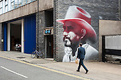 Mural in Hewett Street, Shoreditch, London, a run-down commercial district  also known as Silicon Roundabout, which is undergoing gentrification as it becomes a centre for web-based companies and IT start-ups.