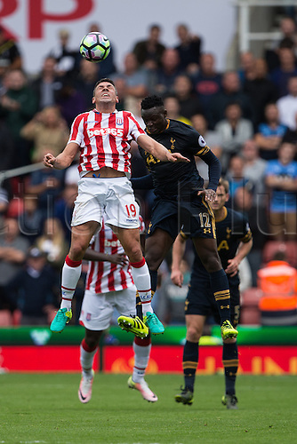 10.09.2016. Bet 365 Stadium, Stoke, England. Premier League Football. Stoke versus Tottenham Hotspur. Stoke City forward Jonathan Walters wins the header in front of Tottenham Hotspur midfielder Victor Wanyama.