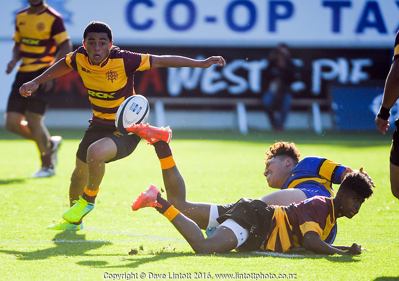 Action from the Auckland 1st XV promotion-relegation match between Otahuhu College (blue and gold) and Liston College (maroon and gold) at Eden Park, Auckland,  New Zealand on Saturday, 30 April 2016. Photo: Dave Lintott / lintottphoto.co.nz