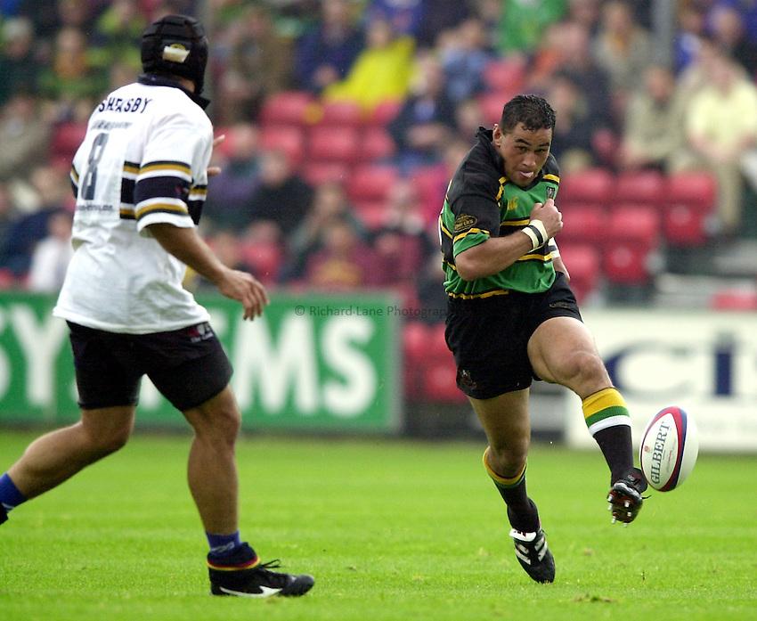 Photo. Richard Lane. .Northampton v London Irish. Zurich Premiership. 26/8/2000..Pat Lam kicks ahead as Chris Sheasby comes in to challenge.